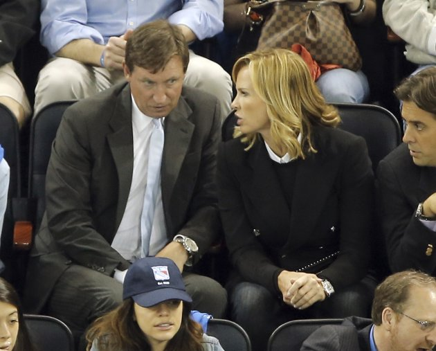 Ex-New York Rangers Hall of Fame player Gretzky sits with wife during Game 3 of the Rangers-Bruins NHL Eastern Conference semi-final playoff hockey series in New York
