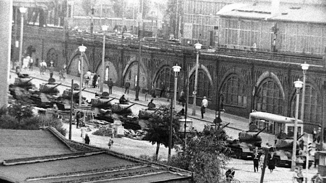 FILE - In this Aug. 13, 1961 b/w file picture East German tanks are lined up at Warschauer Bridge in Berlin, Germany. Crossing points between East and West Berlin were heavily guarded after Communists prevented East Germans from crossing into the West sector in an effort to stop heavy flow of refugees. AP Photographer Peter Hillebrecht was on assignment in Berlin as the construction of the Berlin Wall starts on Aug. 13, 1961 and he was one of the first photographers to  cover this historic event. When the wall was first built, nobody knew what was going to happen next. Many people were afraid that the wall would serve as a provocation and turn to the Cold War into a hot one.  (AP Photo)