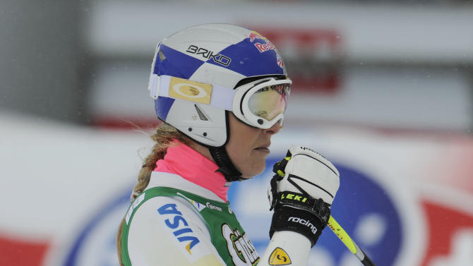 Usa's Linsey Vonn stands at finish line after crashing during the second run of an alpine ski, women's World Cup giant slalom, in Soelden, Austria, Saturday, Oct. 27, 2012. (AP Photo/Giovanni Auletta)