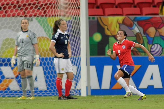 Chile's Maria Rojas Pino, right, celebrates after scoring against Scotland during a match at the International Women's Football Tournament at the National Stadium in Brasilia, Brazil, Wednesda