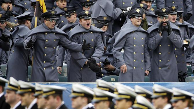 Army cadets, top, call out to Navy midshipmen as they march on the field beforean NCAA college football game, Saturday, Dec. 14, 2013, in Philadelphia