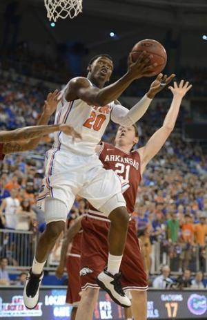 Rosario, Young lead No. 5 Gators past Arkansas