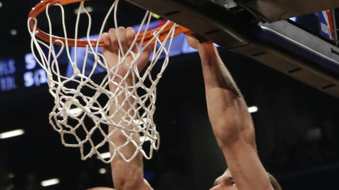 Brooklyn Nets center Brook Lopez dunks during the first half in Game 3 of a first-round NBA basketball playoff series Atlanta Hawks, Saturday, April 25, 2015, at  New York.  (AP Photo/Mary Altaffer)