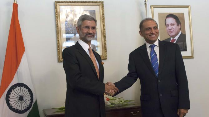 Pakistan's Foreign Secretary Chaudhry shakes hands with his Indian counterpart Jaishankar before their meeting at the Foreign Ministry in Islamabad