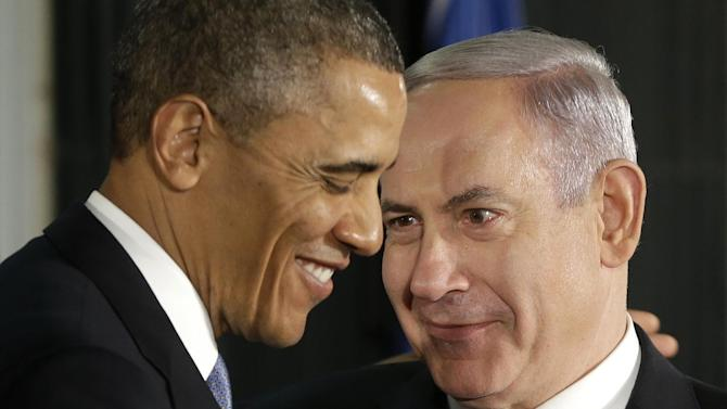 President Barack Obama and Israeli Prime Minister Benjamin Netanyahu huddle during their joint news conference in Jerusalem, Israel,Wednesday, March 20, 2013. (AP Photo/Pablo Martinez Monsivais)
