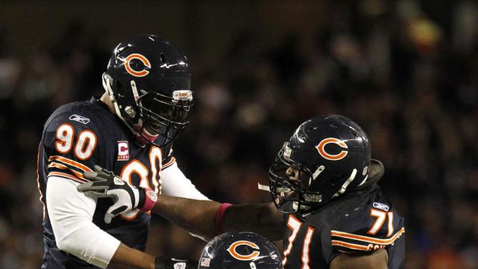Chicago Bears players Julius Peppers (90), Anthony Adams (95), and Israel Idonije (71) celebrate a sack of Minnesota Vikings quarterback Donovan McNabb in the second half of an NFL football game, Sunday, Oct. 16, 2011 in Chicago. (AP Photo/Charles Rex Arbogast)