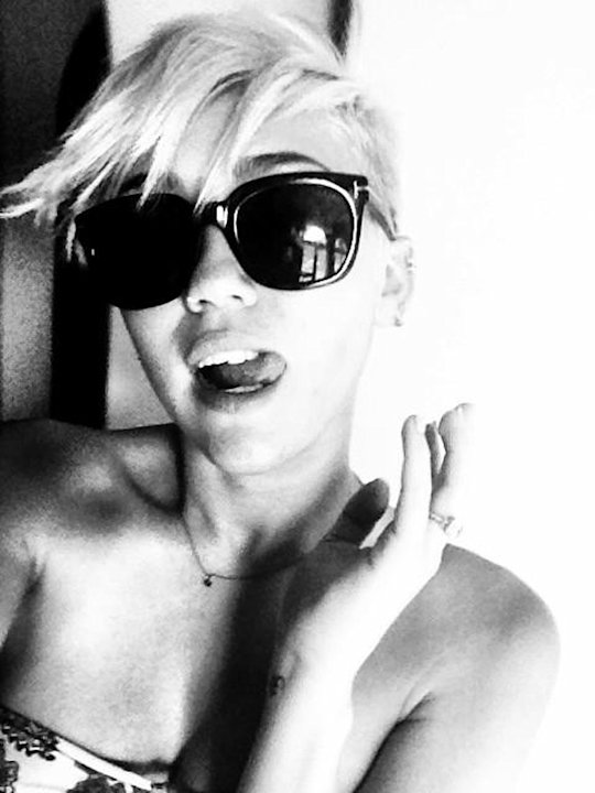 "Celebrity photos: Miley Cyrus tweeted this gorgeous black and white photo of herself wearing a pair of very cool shades. She posted it alongside the caption: ""Love my new Tom Ford sunnies my boooo got"