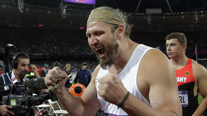 Poland's Tomasz Majewski celebrates winning the gold for the men's shot put during the athletics competition in the Olympic Stadium at the 2012 Summer Olympics, Friday, Aug. 3, 2012, in London. (AP Photo/David J. Phillip)