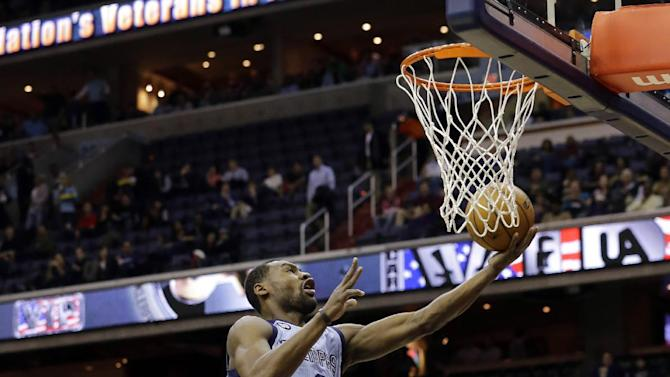 Memphis Grizzlies guard Tony Allen (9) shoots as he goes past Washington Wizards guard John Wall (2) in the first half of an NBA basketball game Monday, March 25, 2013 in Washington. (AP Photo/Alex Brandon)
