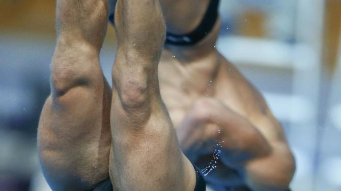 Dorman and Ipsen of the U.S. perform during the men's synchronised 3 metre springboard preliminary at the Aquatics World Championships in Kazan