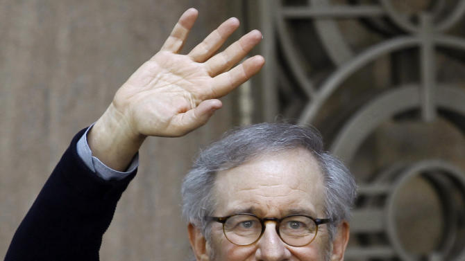"""Director Steven Spielberg waves to the media as he leaves Indian Industrialist Anil Ambani's office in Mumbai, India, Monday, March 11, 2013. Spielberg is in India to celebrate the success of his Oscar-winning film """"Lincoln"""" co-produced by Ambani's Reliance Entertainment. (AP Photo/Rafiq Maqbool)"""