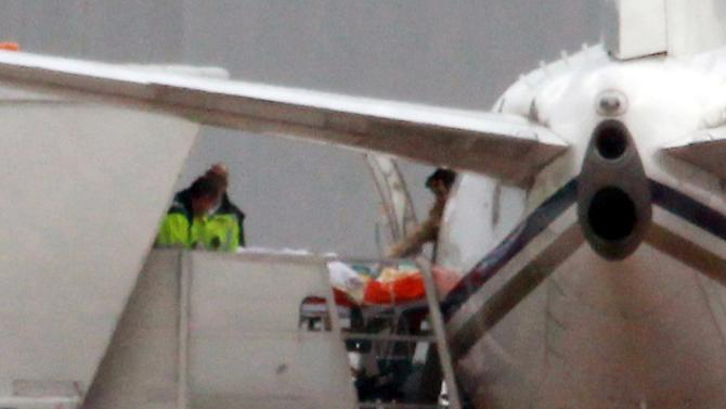 Malala Yousufzai, 14, the Pakistani schoolgirl shot in the head by Taliban gunmen, is transferred from the plane aboard a stretcher as she arrives at Birmingham Airport, England, Monday October 15, 2012. Malala Yousufzai, will receive medical care by doctors and nurses who are specialists in helping British soldiers wounded in Afghanistan and Iraq, after she was shot on a bus in front of her friends for promoting girls' education and criticizing militants.  (AP Photo/David Jones, PA) UNITED KINGDOM OUT - NO SALES - NO ARCHIVES