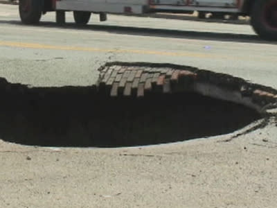 Raw: Woman Rescued After Driving Into Sinkhole