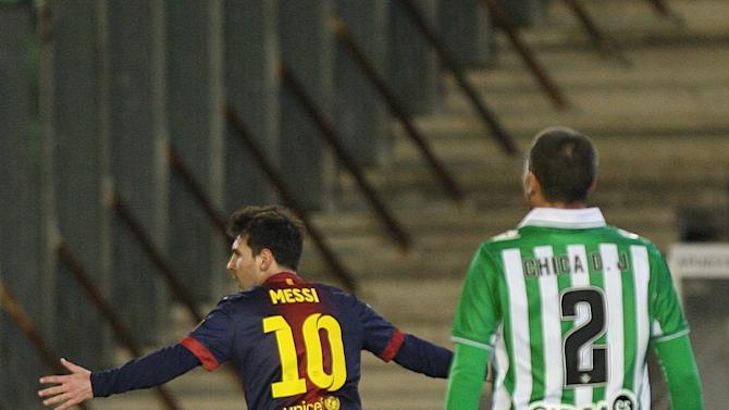 Barcelona's Lionel Messi from Argentina, left, celebrates after scoring against Betis during their La Liga soccer match at the Benito Villamarin stadium, in Seville, Spain on Sunday, Dec. 9, 2012. (AP Photo/Angel Fernandez)
