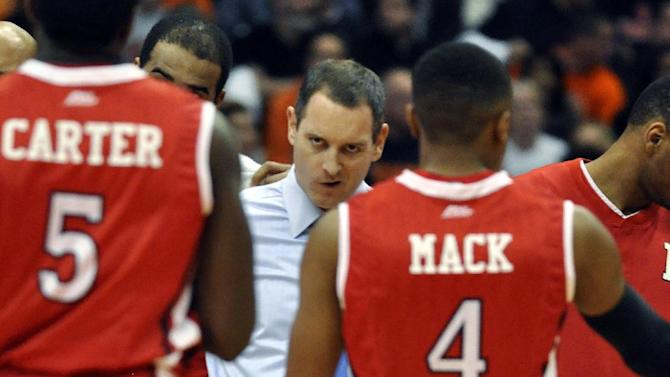 Rutgers head coach Mike Rice glares at Eli Carter (5) during a timeout against Syracuse in the first half of an NCAA college basketball game in Syracuse, N.Y., Wednesday, Jan. 2, 2013. (AP Photo/Kevin Rivoli)
