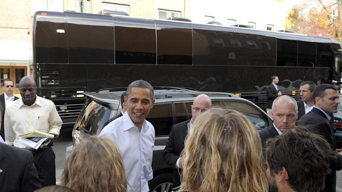 FILE - In this Oct. 17, 2011 file photo, President Barack Obama stands in front of his bus as he greets people in Boone, N.C. President Barack Obama is embarking on his first bus tour of the 2012 campaign, seeking to raise more questions about rival Mitt Romney's business record. At the same time, the president will face another important update on the economy.  (AP Photo/Susan Walsh, File)
