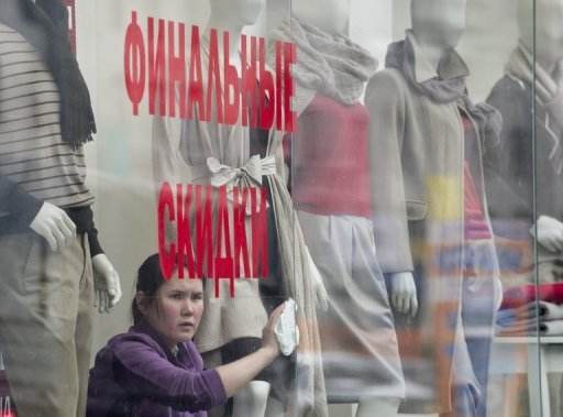 <p>An employee cleans the window of a clothing retail store in Moscow in March 2012. Russia slipped down the global business competitiveness ranking in the years President Vladimir Putin touted economic modernisation as Kremlin chief and premier, a closely-watched survey shows.</p>
