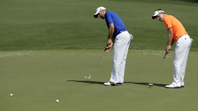 Sergio Garcia, left, of Spain, and Luke Donald, of England, putt on the second green during a practice round for the Masters golf tournament Wednesday, April 4, 2012, in Augusta, Ga. (AP Photo/Darron Cummings)