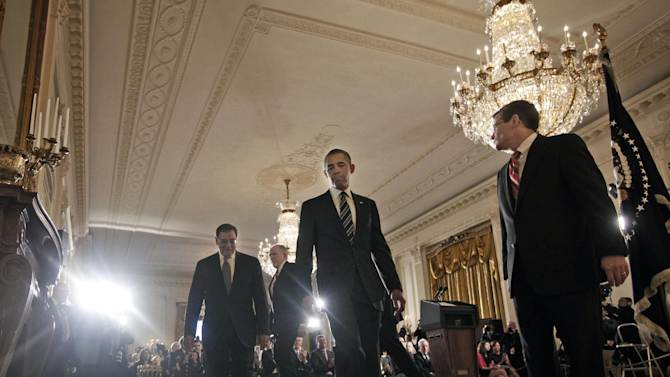 President Barack Obama, center, walks away from the stage in the East Room of the White House in Washington, Monday, Jan. 7, 2013, after announcing that he is nominating Deputy National Security Adviser for Homeland Security and Counterterrorism, John Brennan, second from the left, as the new CIA. From right to left are; Acting CIA Director Michael J. Morell, the president, outgoing Defense Secretary Leon Panetta and Brennan. (AP Photo/Pablo Martinez Monsivais)