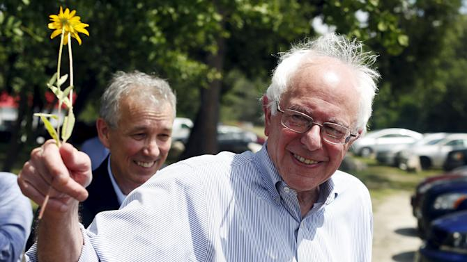 Vermont Senator and U.S. Democratic presidential candidate Bernie Sanders receives a flower at an environmental group's endorsement event in Concord, New Hampshire