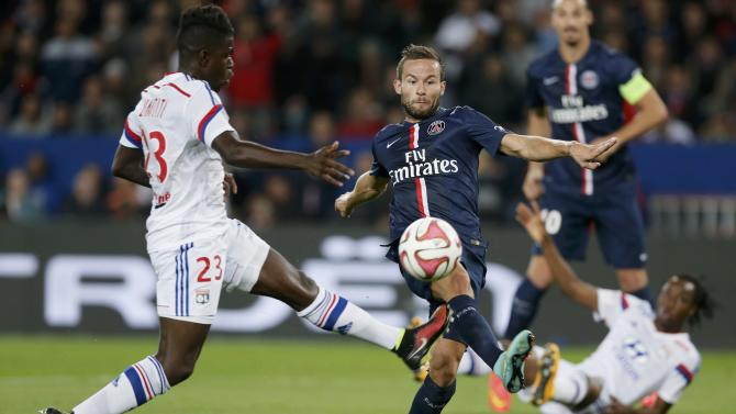 Paris St Germain's Cabaye challenges Olympique Lyon's Fekir during their French Ligue 1 soccer match at the Parc des Princes Stadium in Paris