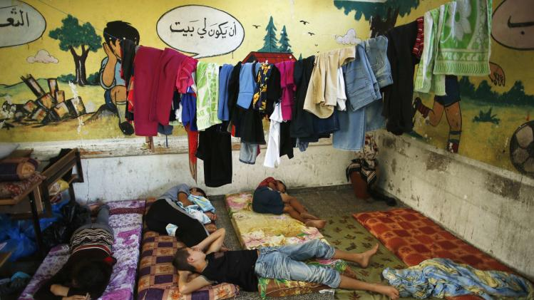 Palestinian children, who fled houses during Israeli ground offensive, sleep at United Nations-run school in which they are staying in Gaza City