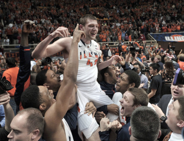 Illinois' Tyler Griffey (42) is hoisted onto his teammates' shoulders after hitting the winning basket, giving Illinois a 74-72 win over No. 1-ranked in an NCAA college basketball game at Assembly Hall in Champaign, Ill., on Thursday Feb. 7, 2013.(AP Photo/John Dixon)