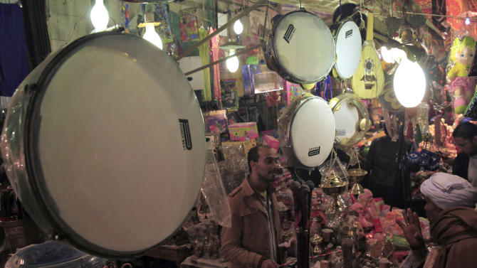 A street vendor sells traditional drums outside Al-Hussein mosque as Muslims celebrate Moulid Al-Hussein, the birthday of Prophet Mohammad's grandson Hussein in old Cairo