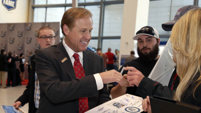 Rusty Wallace signs autographs for fans before making his way into the induction ceremonies for the NASCAR Hall of Fame, Friday, Feb. 8, 2013, in Charlotte, N.C. (AP Photo/Bob Leverone)