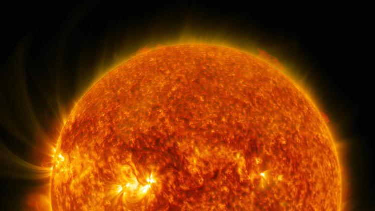NASA handout photo shows moon crossing between NASA's Solar Dynamics Observatory and the sun