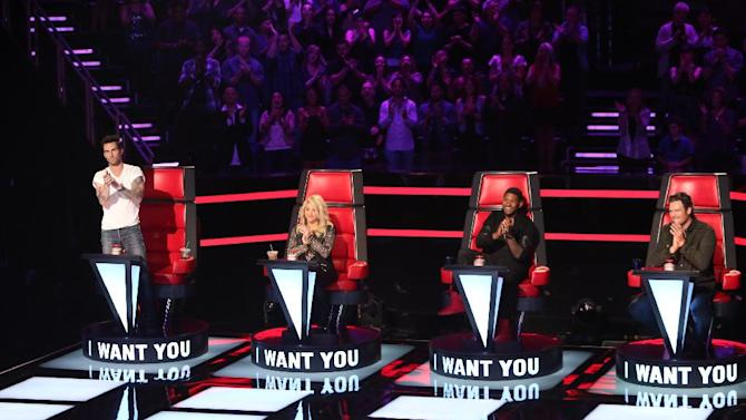 """This undated image released by NBC shows mentors, from left, Adam Levine, Shakira, Usher, and Blake Shelton on the set of the singing competition series, """"The Voice,"""" in Los Angeles. """"The Voice"""" begins its new season 8 p.m. EDT Monday, March 25, with another two-hour episode. NBC said Monday that the show will double to two hours on April 30 and May 7 to showcase pivotal rounds in the singing competition. (AP Photo/NBC, Adam Taylor)"""