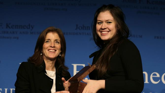 Caroline Kennedy, daughter of the late President John F. Kennedy, poses with Veronika Scott, right, after presenting the annual Frontier Award at the John F.Kennedy Library in Boston, Monday, Nov. 19, 2012. Scott, was honored for her project in Detroit that provides jobs for female shelter residents, who make coats for the homeless that transform into sleeping bags. (AP Photo/Charles Krupa)