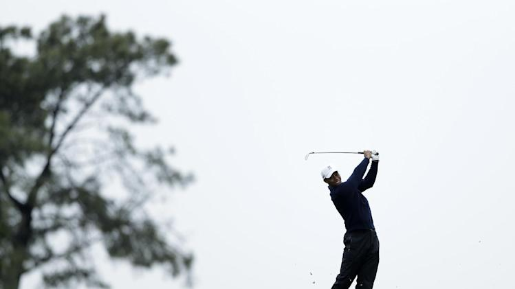 Tiger Woods hits his second shot on the 14th fairway of the north course at Torrey Pines Golf Course during the second round of the Farmers Insurance Open golf tournament Friday, Jan. 25, 2013, in San Diego. (AP Photo/Gregory Bull)