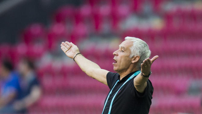 France's head coach Pierre Mankowski gestures during the Under-20 World Cup Group A soccer match between France and the U.S. in Istanbul, Turkey, Monday, June 24, 2013. (AP Photo/Gero Breloer)