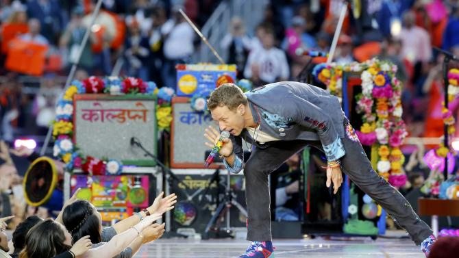 Chris Martin, lead singer of Coldplay, performs during the half-time show at the NFL's Super Bowl 50 between the Carolina Panthers and the Denver Broncos in Santa Clara