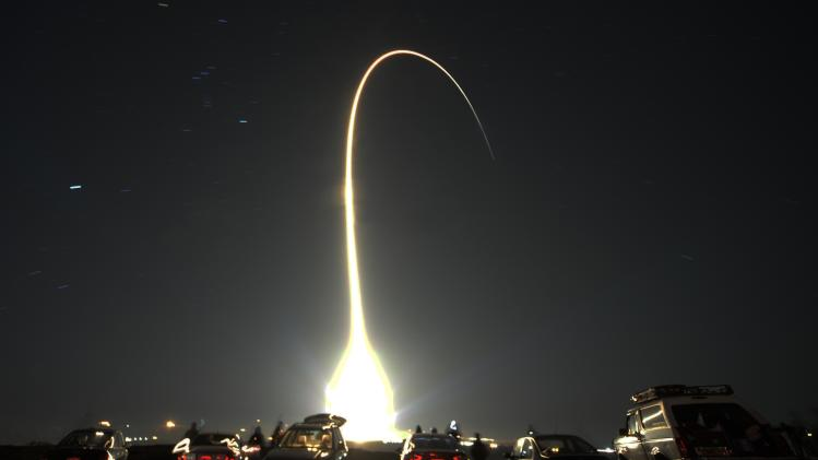 People watch as a United Launch Alliance Atlas 5 rocket, carrying a classified payload from the U.S. government's National Reconnaissance Office, lifts-off on Thursday night at the Vandenberg AFB