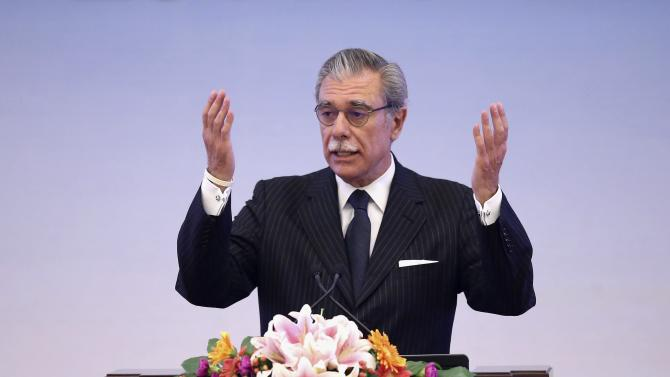 Former U.S. Secretary of Commerce Carlos Gutierrez speaks during the opening session of the China's Conference of Quality at the Great Hall of the People in Beijing