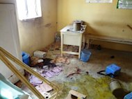 "Dried blood stains and abandoned polio vaccine kits litter the floor of Haye dispensary on February 8, 2013 in the northern Nigerian city of Kano. President Goodluck Jonathan condemned the ""dastardly terrorist attacks"""