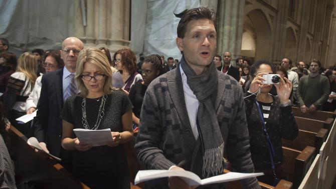 People sing carols during a midnight mass at St Patrick's Cathedral in the Manhattan borough of New York