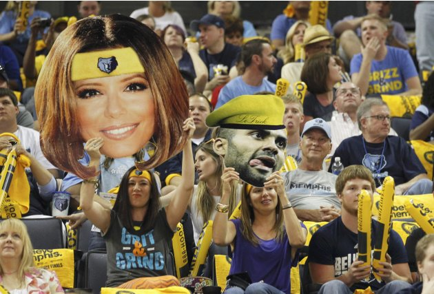 Memphis Grizzlies fans hold pictures of San Antonio Spurs' Tony Parker and his ex-wife Eva Longoria during the first quarter in Game 3 of their NBA Western Conference final playoff basketball series i