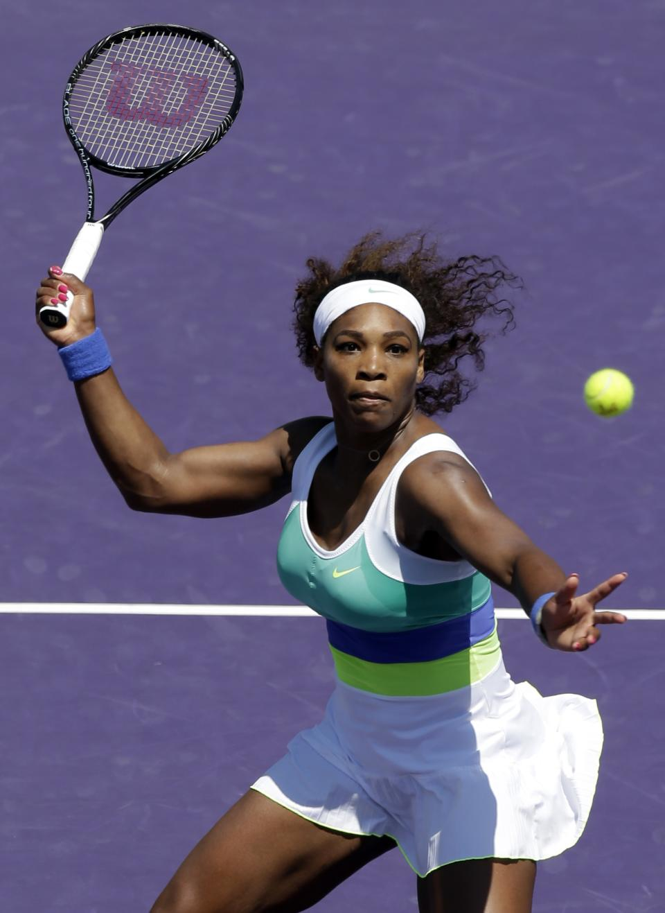 Serena Williams returns a shot to Maria Sharapova, of Russia, during the final match of the Sony Open tennis tournament, Saturday, March 30, 2013, in Key Biscayne, Fla. (AP Photo/Wilfredo Lee)