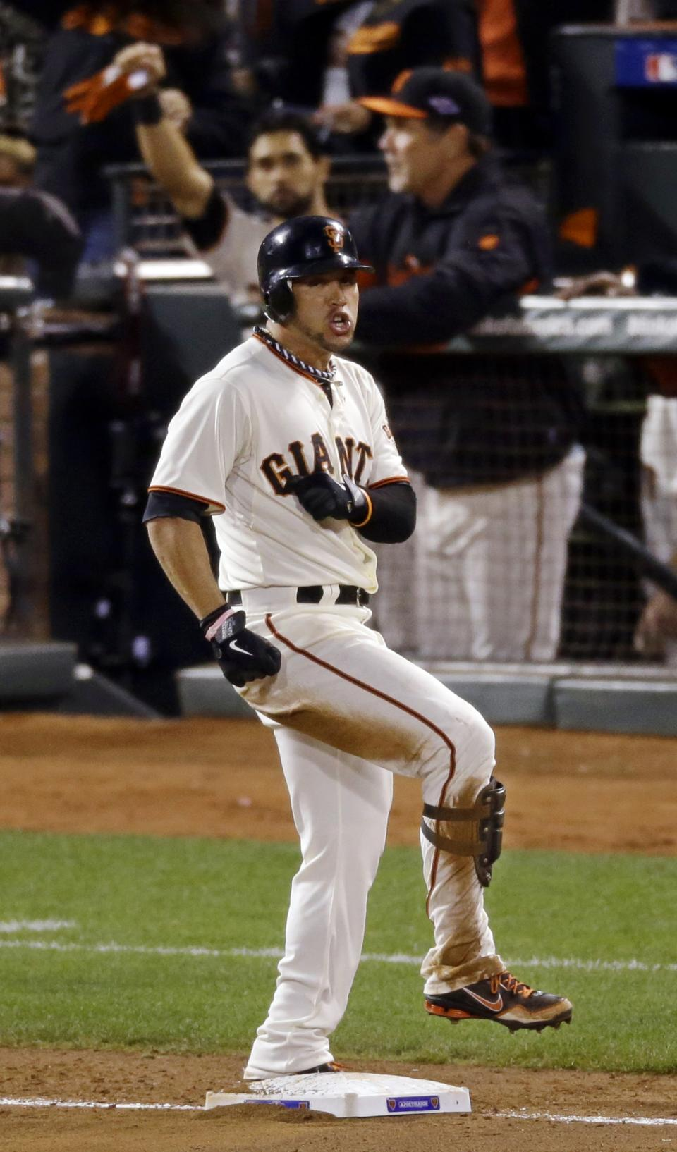 San Francisco Giants' Gregor Blanco reacts after hitting a three-run triple during the fourth inning of Game 1 of baseball's National League championship series against the St. Louis Cardinals Sunday, Oct. 14, 2012, in San Francisco. (AP Photo/Mark Humphrey)