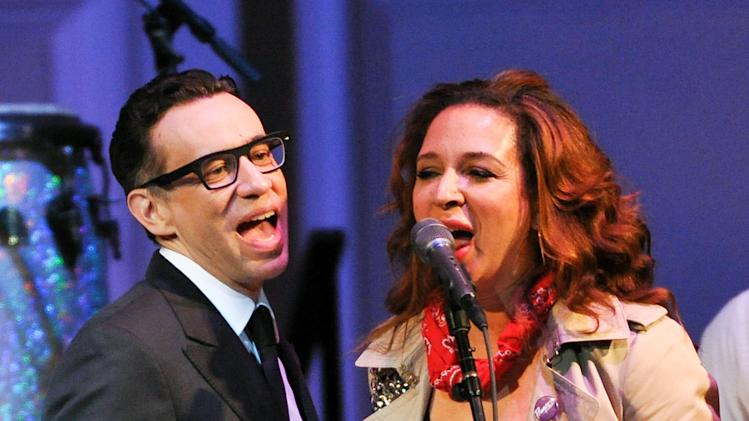 "Actors Fred Armisen and Maya Rudolph perform at ""The Music of Prince"" tribute concert at Carnegie Hall on Thursday March 7, 2013 in New York. (Photo by Evan Agostini/Invision/AP)"