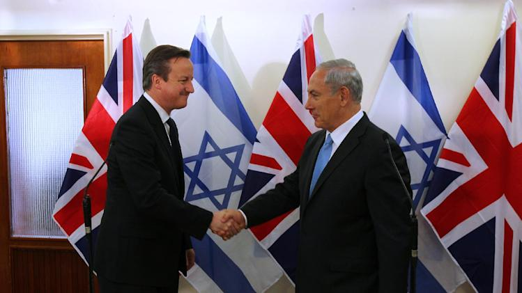 British Prime Minister David Cameron, left, shakes hands with his Israeli counterpart Benjamin Netanyahu after delivering joint statements in Jerusalem on Wednesday, March 12, 2014. Cameron made his first visit as British leader to Israel and plans to visit the Palestinian territories this week. (AP Photo/Ronen Zvulun, Pool)