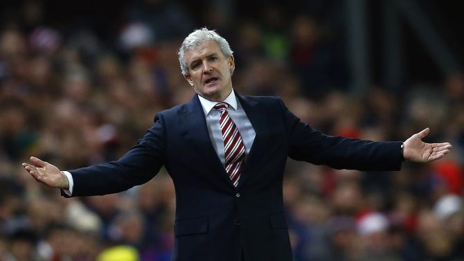 Stoke City manager Hughes reacts during their English Premier League match against Chelsea in Stoke-on-Trent