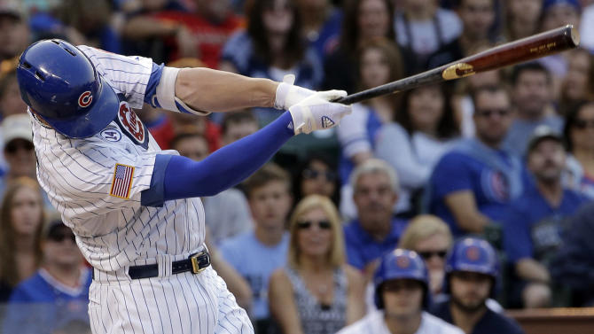 Chicago Cubs' Kris Bryant hits a grand slam during the second inning of a baseball game against the Miami Marlins, Saturday, July 4, 2015, in Chicago. (AP Photo/Nam Y. Huh)