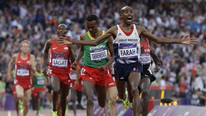 Britain's Mohamed Farah celebrates as he crosses the finish line to win the men's 5000-meter final during the athletics in the Olympic Stadium at the 2012 Summer Olympics, London, Saturday, Aug. 11, 2012. (AP Photo/Anja Niedringhaus)