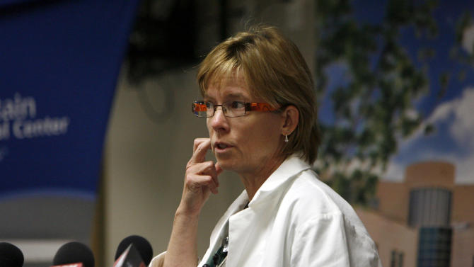 Dr. Barbara Kerwin, ICU medical director at McKay-Dee Hospital, talks about the entry of the bullet to the head of James Evans during a news conference at the hospital in Ogden, Utah on Monday, June 17, 2013. James Evans, 65, who was shot in the head in front of a congregation of 300 people on Sunday, was in critical condition Monday, but has made steady progress, said Kerwin. (AP Photo/The Salt Lake Tribune, Francisco Kjolseth) DESERET NEWS OUT; LOCAL TV OUT; MAGS OUT