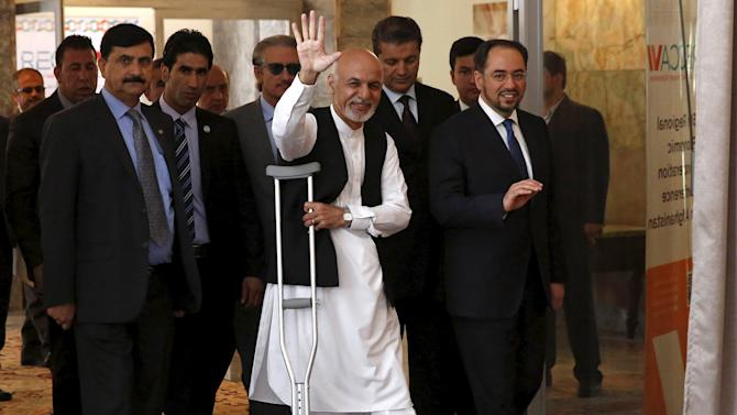 Afghanistan's President Ashraf Ghani gestures as he arrives to attend the RECCA in Kabul