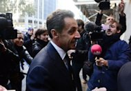 "Former French president Nicolas Sarkozy arrives to address a Brazilian investment bank conference in New York, on October 11. Five months after losing re-election, an unshaven Sarkozy reportedly said he looked forward to a ""new life."""